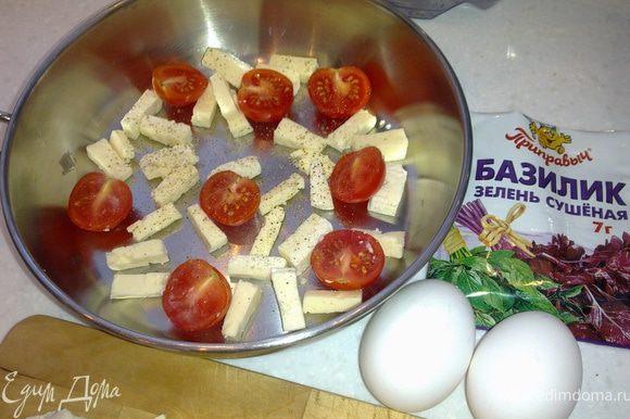 Для начала надо разогреть духодку до 250 гр. Пока духовка греется,мы занимаемся приготовлением.В форму,в которой будем готовить завтрак положить сл.масла. Нарезаем сыр произвольно,кому как нравится. Помидорки черри режем на две части.Первую порцию сыра и помидор отправляем в сковороду.