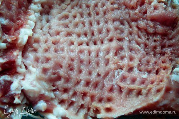Нарезать кусками толщиной около 1см.Отбить молоточком.Нарезать затем на тонкие полосочки или брусочки.