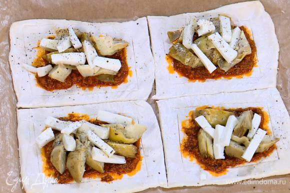 Центр каждого квадрата смазать соусом песто, выложить артишоки и козий сыр, все слегка посолить и поперчить.