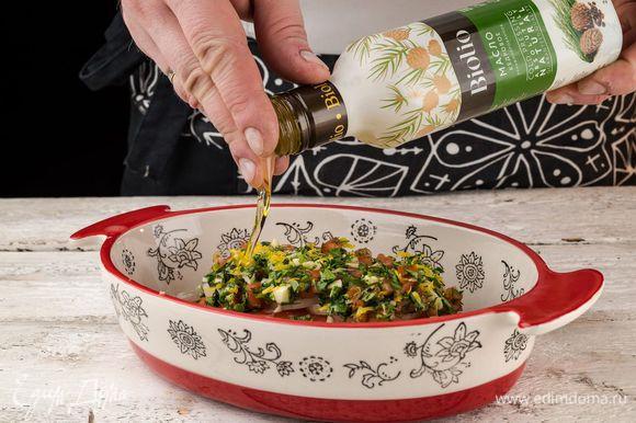 Перед отправкой рыбы в духовку сбрызните ее кедровым маслом Biolio и поставьте форму в разогретую до 200°С духовку.
