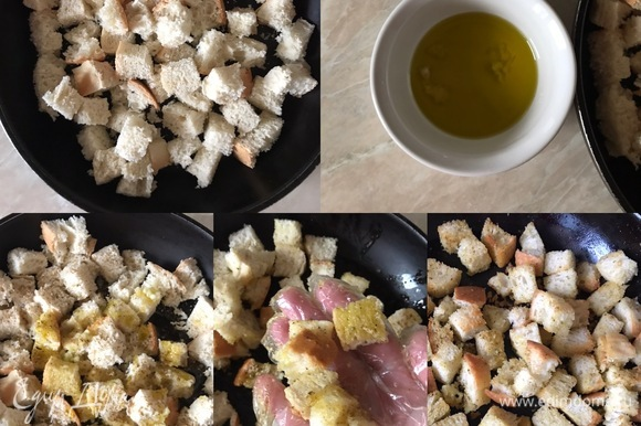 Первым делом готовим сухарики. Я сделала много, так как они прекрасно хранятся несколько дней, но, если вам столько не нужно, то уменьшите количество. Итак, духовку нагреть до 200°C. Хлеб нарезать небольшими кубиками, переложить в форму для выпечки и посыпать сванской солью. В пиале смешать масло, орегано и чеснок. Полить сухарики маслом, хорошо перемешать и поставить в духовку на 8–10 минут.