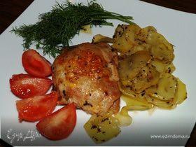Куриные бедрышки с ароматными картофельными ломтиками